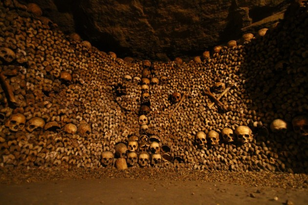 A cross made of skulls in an alcove